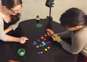 Two students playing the shaping game PORTL