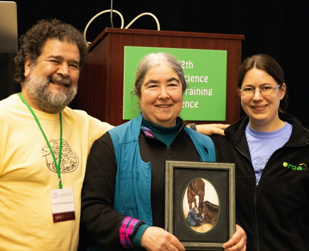 Alexandra Kurland, Dr. Jesús Rosales-Ruiz and Mary Hunter pose for a photo after Alexandra receives the 2020 Anderson Award